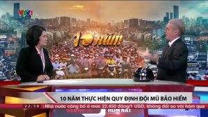 "AIP Foundation President Greig Craft interviewed with news anchor Ms. Thu Ha of ""Today's Issues"" to discuss 10 years of implementing Vietnam's national helmet law."