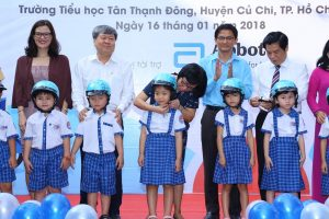 Students from Tan Thanh Dong Primary School receive new quality helmets as part of our Helmets for Families program.