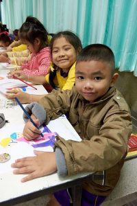 Students learn about road safety concepts through fun coloring activities organized by their teachers.