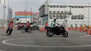 Youth road safety ambassadors practice their driving skills on the Honda course.