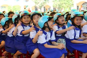 Students from Tan PhuTrung Primary School in the Cu Chi District of Ho Chi Minh City participate in the Helmets for Families road safety festival.