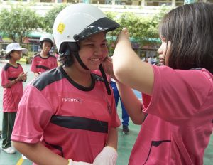 Students demonstrating proper helmet use during the extra-curricular activities.