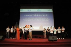 Students play a traffic safety game onstage with workshop facilitators
