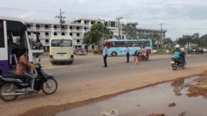Buses are slowly replacing flat-bed trucks as worker transportation vehices in Bavet, Cambodia