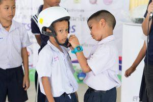 Students demonstrating proper helmet wearing.