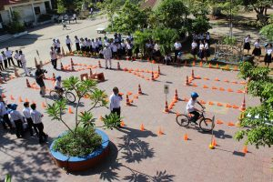 Students practice their bicycle driving skills on the road safety course.