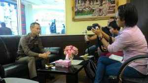 Pol. Lt. Colonel Dr. Panupong Panudulkitti, Inspector of the Traffic Police Division and LDP member, is interviewed by journalists.