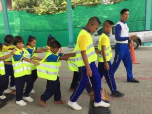 Students participating in road safety games.